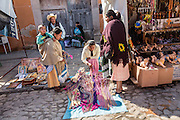 Mexican religious pilgrims and penitents purchase rope whips from a vendor outside the Sanctuary of Atotonilco, and important Catholic shrine in Atotonilco, Mexico.