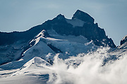 """Castaño Overo Glacier. Cerro Tronador is an extinct stratovolcano in the southern Andes, near Bariloche, in the Lake District of Argentina. The sound of falling seracs gave it the name Tronador, Spanish for """"Thunderer."""" With an altitude of 3470 m, Tronador stands more than 1000 meters above nearby mountains in the Andean massif, making it a popular climb in Patagonia, South America. Located inside two National Parks, Nahuel Huapi in Argentina and Vicente Pérez Rosales in Chile, Tronador hosts eight glaciers, which are retreating due to warming of the upper troposphere."""