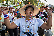 "01 FEBRUARY 2014 - BANGKOK, THAILAND: An anti-government protestors celebrates the blocking on a polling place in central Bangkok. Thais went to the polls in a ""snap election"" Sunday called in December after Prime Minister Yingluck Shinawatra dissolved the parliament in the face of large anti-government protests in Bangkok. The anti-government opposition, led by the People's Democratic Reform Committee (PDRC), called for a boycott of the election and threatened to disrupt voting. Many polling places in Bangkok were closed by protestors who blocked access to the polls or distribution of ballots. The result of the election are likely to be contested in the Thai Constitutional Court and may be invalidated because there won't be quorum in the Thai parliament.    PHOTO BY JACK KURTZ"