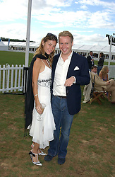 JOE BAMFORD and MICHELLE ADAMSON at the 2005 Cartier International Polo between England & Australia held at Guards Polo Club, Smith's Lawn, Windsor Great Park, Berkshire on 24th July 2005.<br />