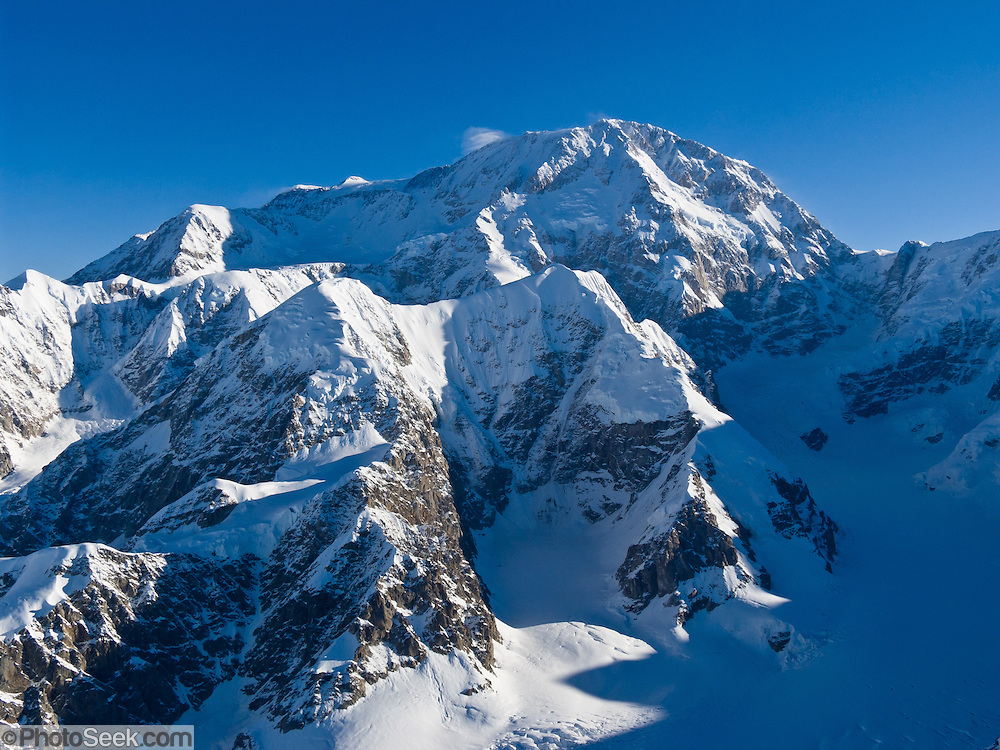 Flightsee over the Alaska Range and Denali National Park and Preserve, in Alaska, USA. See a vast wilderness of glaciers, icy peaks, and mile deep granite gorges.