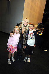 """ADELA KING with her children LATIMER and DAKOTA at a VIP Opening night of Disney & Pixar's """"Finding Nemo on Ice"""" at The O2 Arena Grennwich London on 23rd October 2008."""