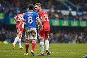 Accrington Stanley Forward, Billy Kee (29) comes together with Portsmouth Midfielder, Michael Doyle (8) during the EFL Sky Bet League 2 match between Portsmouth and Accrington Stanley at Fratton Park, Portsmouth, England on 11 February 2017. Photo by Adam Rivers.