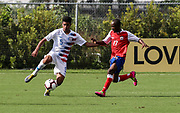Team USA defender Antonio Leone (5) dribbles the ball and avoids the tackle from Team Haiti forward Wilgene Dambreville (17) during a CONCACAF boys under-15 championship soccer game, Sunday, Aug. 4, 2019, in Bradenton, Fla. The USA defeated Haiti 2-0 (Kim Hukari/Image of Sport)