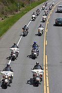 Hurley, New York  - Police officers on motorcycles lead the motorcade escorting the body of  U.S. Army Sgt. Shawn M. Farrell II on Route 209 on May 7, 2014. Farrell died April 28 when forces attacked his unit with small arms fire in Afghanistan.