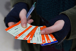 © under license to London News Pictures. 02/01/14. An average 2.8% increase in rail fares comes into effect on Thursday 2nd Jan 2014, pushing the cost of some commuter travel to more than £5,000 a year. FILE PICTURE DATED: 28/11/2012. A passenger holding her train tickets after buying them from a ticket machine at Victoria Train Station. Rail fares set to increase by an average of 4.2% in January, a watchdog has revealed. Photo credit: Tolga Akmen/LNP