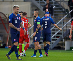 TRNAVA, SLOVAKIA - Thursday, October 10, 2019: Slovakia's Norbert Gyömber walks off after being shown a red card and sent off for a second yellow during the UEFA Euro 2020 Qualifying Group E match between Slovakia and Wales at the Štadión Antona Malatinského. (Pic by David Rawcliffe/Propaganda)