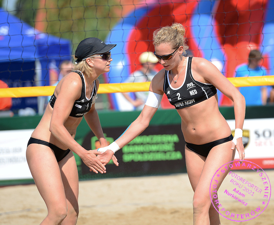 STARE JABLONKI POLAND - July 3:  Sanne Kaizer /1/ and Marleen van Iersel of Netherlads in action during Day 3 of the FIVB Beach Volleyball World Championships on July 3, 2013 in Stare Jablonki Poland.  (Photo by Piotr Hawalej)