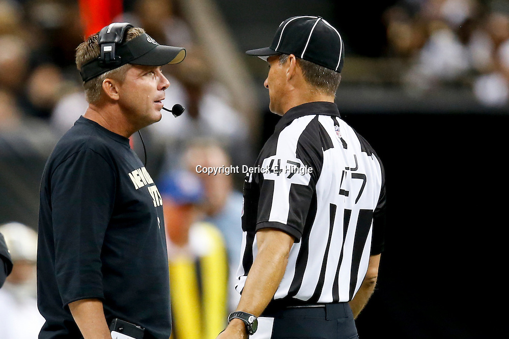 Aug 9, 2013; New Orleans, LA, USA; New Orleans Saints head coach Sean Payton talks with line judge Tim Podraza (47) during the first half of a preseason game at the Mercedes-Benz Superdome. The Saints defeated the Chiefs 17-13. Mandatory Credit: Derick E. Hingle-USA TODAY Sports