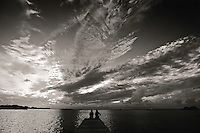 Two women take in sunset in San Pedro, Belize. Copyright 2014 Reid McNally.