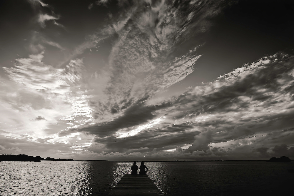 Two women take in sunset in San Pedro, Belize. Copyright 2014 Reid McNally.