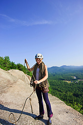 A collects a climbing rope after a climb on Cathedral Ledge.  Echo Lake State Park in North Conway, New Hampshire.  White Mountains.