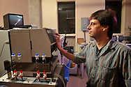 Researchers, Steve Hartson and Bob Matts, use a new top of the line machine to research cancer cells.