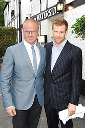 Left to right, chefs HESTON BLUMENTHAL and TOM AIKENS at a party to celebrate The Waterside Inn's 25 years as a 3 star Michelin restaurant held at The Waterside Inn, Bray, Berkshire on 18th May 2010.