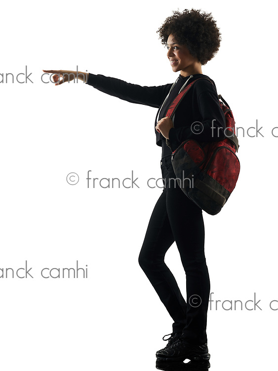 one mixed race african young teenager girl woman standing pointing in studio shadow silhouette isolated on white background