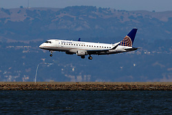 Embraer ERJ-175LR (N160SY) operated by SkyWest Airlines for United Express landing at San Francisco International Airport (KSFO), San Francisco, California, United States of America