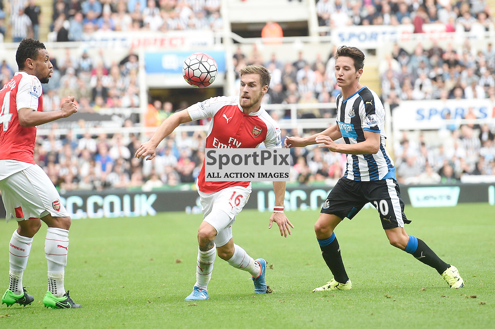 Aaron Ramsey (left) and Florian Thauvin (right) in the Newcastle United v Arsenal Barclays Premier League match at St James' Park Newcastle 09 August 2015<br /> <br /> (c) Greg Macvean / SportPix.org.uk