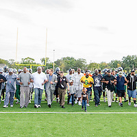 Life Remodeled CEO Chris Lambert, Cody High football coach Calvin Norman, sponsors and supporters lock arms and walk length of new field during celebration on Detroit's West Side.