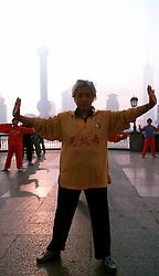 CHINA SHANGHAI MAY99 - An elderly Chinese woman practices Tai Chi on the Bund early in the morning...jre/Photo by Jiri Rezac..© Jiri Rezac 1999..Contact: +44 (0) 7050 110 417.Mobile:  +44 (0) 7801 337 683.Office:  +44 (0) 20 8968 9635..Email:   jiri@jirirezac.com.Web:    www.jirirezac.com..© All images Jiri Rezac 1999 - All rights reserved.