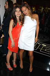 JADE JAGGER and her daughter ASSISI  at a party hosted by Versace during London Fashion Week 2005 at their store in Slaone Street, London on 19th September 2005.<br />