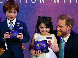 The Duke of Sussex poses for a photograph with award winner Lyla-Rose O'Donovan and co-winner Dexter Spence during the annual WellChild Awards at the Royal Lancaster Hotel, London.