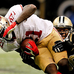 November 25, 2012; New Orleans, LA, USA; New Orleans Saints middle linebacker Curtis Lofton (50) tackles San Francisco 49ers running back Frank Gore (21) during the second half of a game at the Mercedes-Benz Superdome. The 49ers defeated the Saints 31-21. Mandatory Credit: Derick E. Hingle-US PRESSWIRE
