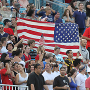USA fans hold up flags during an international friendly soccer match between Scotland and the United States at EverBank Field on Saturday, May 26, 2012 in Jacksonville, Florida.  The United States won the match 5-1 in front of 44,000 fans. (AP Photo/Alex Menendez)