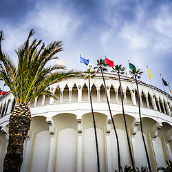 Avalon Casino Catalina Island photo with dramatic blue cloudy sky. The Avalon Casino is a historic art deco movie theatre built in 1929 by the Wrigley family. Catalina Island is a popular travel desination off the coast of Southern California in the United States.