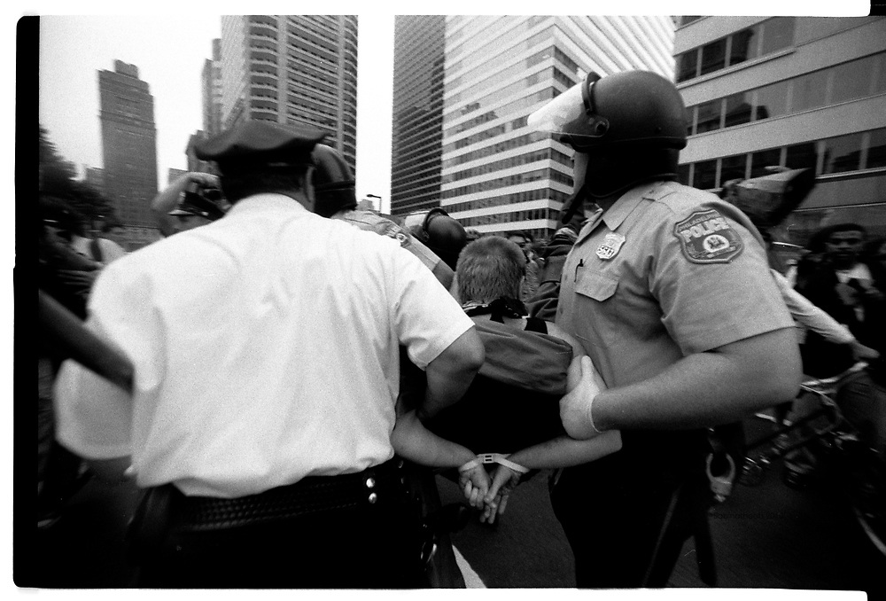 Philadelphia police arrest a protester during the RNC