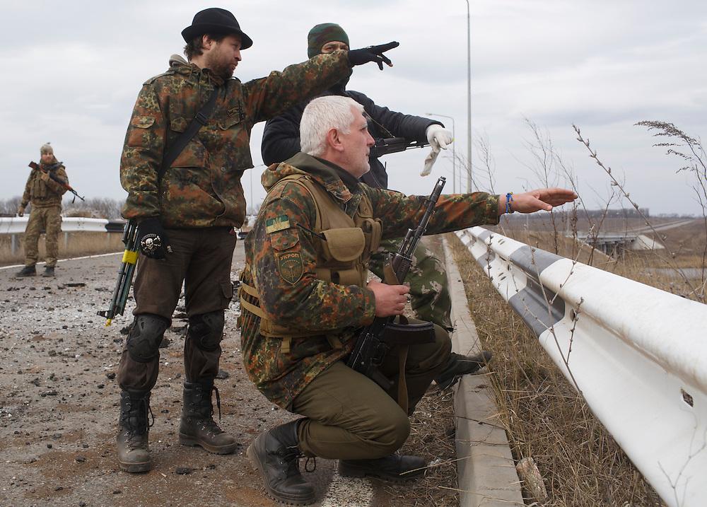 Members of Carpathian Sich battalion patrol near the bridge on March 19, 2015 near Pisky, Ukraine.