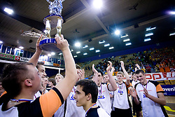 Players of Novo mesto celebrate with a cup at SKL finals volleyball match between Solski center Novo mesto and Solski center Slovenj Gradec followed by cup and medal ceremony, on April 22, 2009, in Hall Tivoli, Ljubljana, Slovenia. Win of SC Novo mesto.  (Photo by Vid Ponikvar / Sportida)