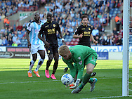 Ben Amos goalkeeper of Bolton Wanderers fumbles the ball during the Sky Bet Championship match at the John Smiths Stadium, Huddersfield<br /> Picture by Graham Crowther/Focus Images Ltd +44 7763 140036<br /> 19/09/2015
