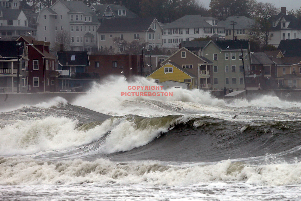 Waves smash over the seawall on Winthrop Shore Dr. this morning, October 29, 2012, as Hurricane Sandy moves closer to the region. Staff photo by Mark Garfinkel