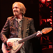 Tom Petty smiles while playing with his band The Hartbreakers during the frist night of a 2 night stand at The Gorge Ampitheater, George, WA on June 11, 2010