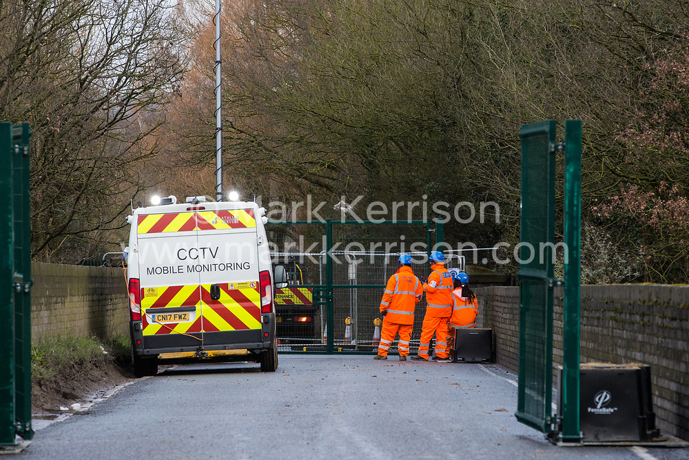 Harefield, UK. 8 February, 2020. HS2 engineers and a CCTV surveillance vehicle monitor a road closure implemented on the busy Harvil Road in the Colne Valley to carry out tree felling works for the high-speed rail project. Environmental activists prevented the tree felling by HS2.
