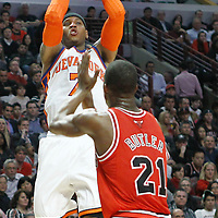 12 March 2012: New York Knicks small forward Carmelo Anthony (7) takes a jumpshot over Chicago Bulls guard Jimmy Butler (21) during the Chicago Bulls 104-99 victory over the New York Knicks at the United Center, Chicago, Illinois, USA.