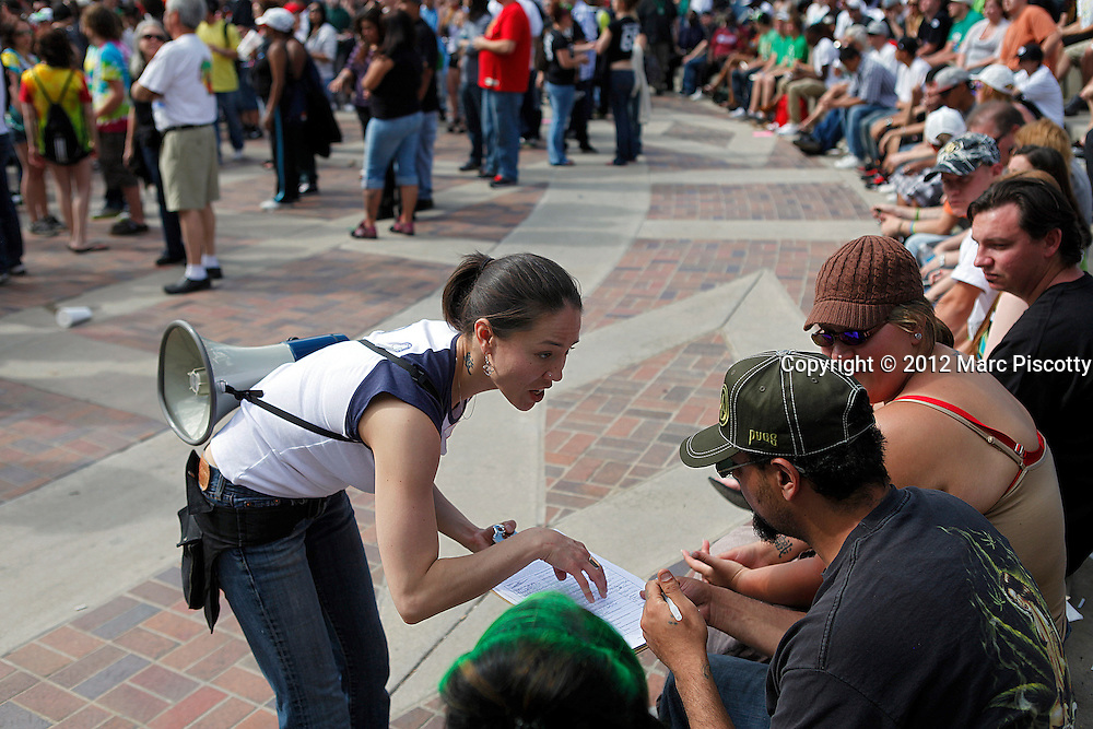 DENVER, CO - APRIL 20: Crystal Guess of Denver, Co. attempts to gather signatures for Initiative 70 which would remove marijuana from the controlled substances list in Colorado among other things. An estimated 10,000 people are expected to gather in Civic Center Park in Denver, Colorado on April 20, 2012 to celebrate the state's Medicinal Marijuana laws and collectively light up at 4:20pm. On Nov. 6, Colorado may become the first state to legalize marijuana with the passing of Amendment 64, a controversial ballot initiative that would permit up to 1 ounce of possession for those 21 and older. (Photo by Marc Piscotty/ © 2012)