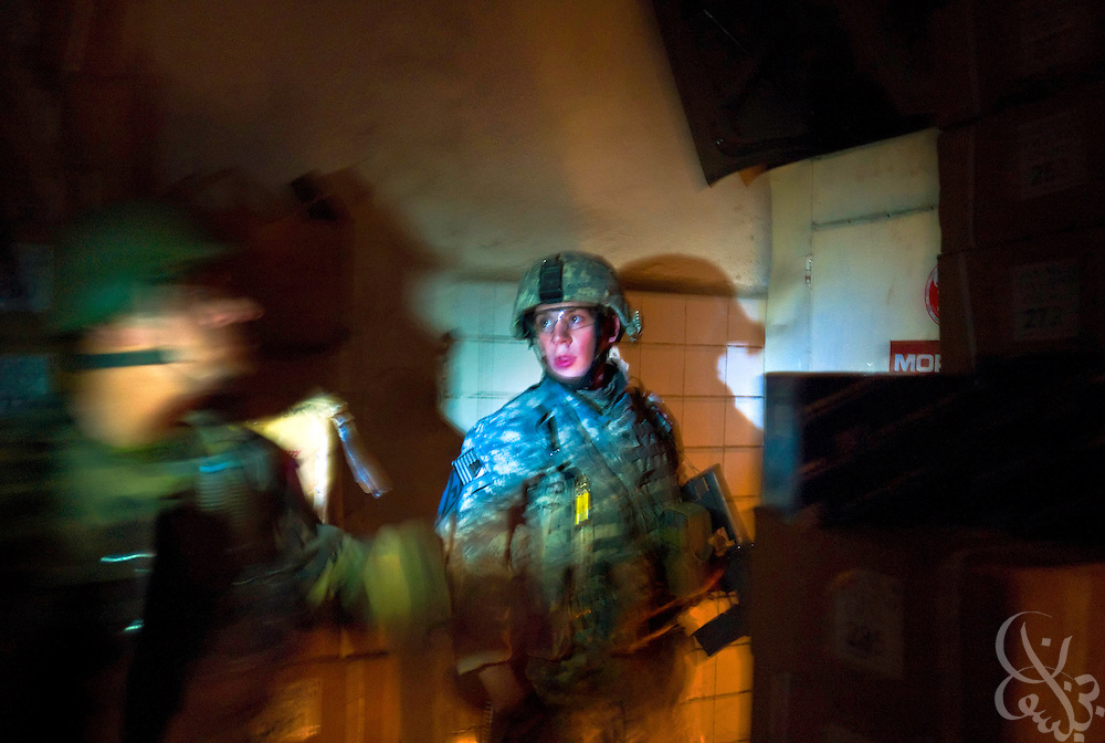 A U.S. Army 1st Cavalry division 2-7 soldier stands guard as Iraqi Army 2nd Division soldiers sweep through a mechanics shop and warehouse searching for hidden weapons caches October 14, 2007 in Mosul, Iraq. The U.S. military has been able to lower the number of troops it has on the streets of Mosul over the past year as Iraqi security forces in the area have taken an increasing role in providing day-to-day security.