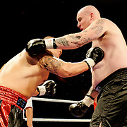 June 19, 2009 - Richmond, BC - Rumble at the Rock IV - Heavyweight fighters Paul Cheng of Vancouver, BC, and Devon Garnon of Calgary, Alberta, squared off in a four round non-title bout..The battle between Cheng (2-0) and  Garnon (0-3) ended early when Cheng, the former B.C. Lions draft choice, landed a powerful right to Garnon's jaw stopping the bout at 1:10 of the first round..The River Rock Casino Resort hosted the West Coast Promotions Rumble at the Rock VI boxing event at the River Rock Show Theatre.