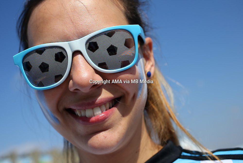 A fan of Argentina wearing football glasses