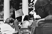 GLASGOW, KY – JULY, 2006: A child waves an American flag at a veterans day event.
