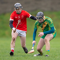 O'Callaghan's Mill's Sean Cotter is challenged by Eire Og's Kevin Brennan