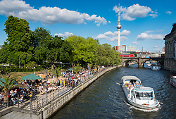 Outdoor riverside bar in Monbijoupark  beside Spree River in summer in Berlin, Germany