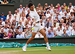 LONDON, ENGLAND - Saturday, July 14, 2018: Novak Djokovic (SRB) during the Gentlemen's Singles Semi-Final match on day twelve of the Wimbledon Lawn Tennis Championships at the All England Lawn Tennis and Croquet Club. (Pic by Kirsten Holst/Propaganda)