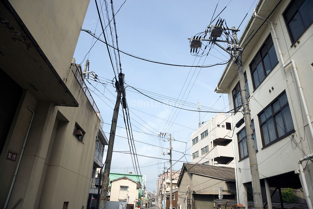 many utility cables are a common view in the street in Japan