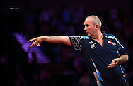 Phil 'The Power' Taylor in action during his final match against Robert Thornton in the Betway Premier League Darts at the Brighton Centre in Brighton, East Sussex. PRESS ASSOCIATION Photo. Picture date: Thursday 15th May, 2014. Photo credit should read: Chris Ison/PA Wire.