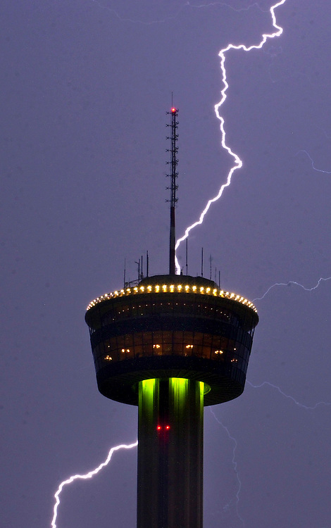 A bolt of lightning flashes behind the Tower of the Americas Tuesday night as a rainstorm moved through San Antonio.