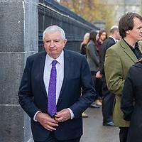 former Irish Fianna Fáil politician Brendan Daly arrives at the funeral of musician Mícheál Ó'Súilleabháin at St Senans Church Kilrush