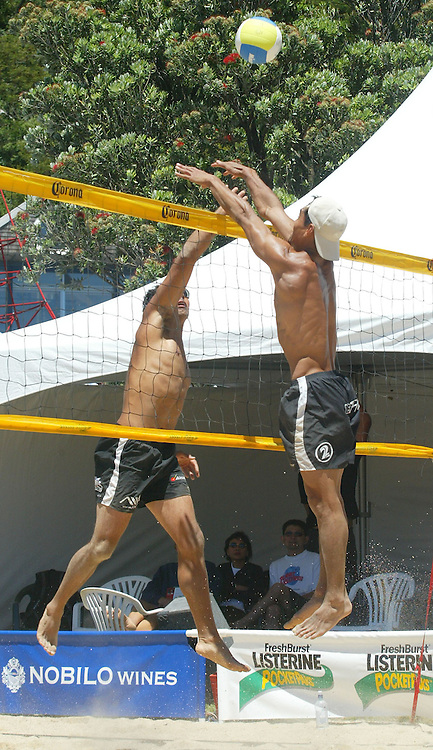 10 January 2004, Oriental Beach Wellington,<br />International Beach Volleyball Pro Tour<br />Auckland's Craig Seuseu spikes the ball past Auckland's Lefu Leaupepe during pool play at the International Beach Volleyball Tour Wellington's Oriental Parade.<br />Please Credit: Marty Melville/Photosport
