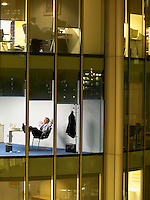 Business man relaxing in office view from building exterior